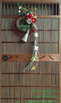 Japanese decoration for New Year, Shime-kazari しめ飾り - a twisted straw rope with fern leaves, an orange and other items of good omen. It is generally hung on doors during the New Year holidays and served as a charm against evil spirits in Japan.
