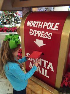 Morrisa mailing Santas letter, 2013