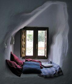 cozy reading nook in cob house