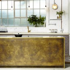 Selected for its rich colour and hardwearing qualities, brass is a key material in our palette.