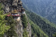 Taktsang Palphug Monastery. Located in the cliffside of the upper Paro valley, in Bhutan. Photo Credit: Getty�  via @AOL_Lifestyle Read more: http://www.aol.com/article/news/2016/12/12/18-astonishing-places-of-worship-from-around-the-world/21626108/?a_dgi=aolshare_pinterest#fullscreen