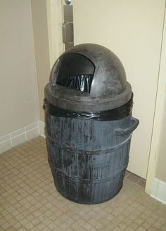 A bathroom at Disney's Fort Wilderness Campground still features a barrel-shaped trash can, which were featured in the River Country water park, closed since 2001 (via MagicalTrash.com)