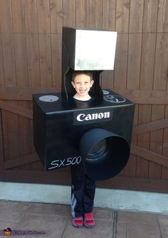 Riley: My son loves electronics and gadgets and he thought it would be cool to be a camera for Halloween. The camera and flash are constructed from cardboard with black and...