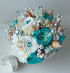 Current creation time for this bouquet is about 2 weeks before shipping. -------------------------------------oooOOOooo---------------------------------------- This sophisticated seashell wedding bouquet is a creative alternative to a flower wedding bouquet. Such bouquet will never