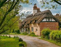 These 16th Century thatched cottages in Charlton, Andover were once the Buck and Dog Public House by Anguskirk, via Flickr