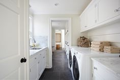 TR Building & Remodeling - laundry/mud rooms - long laundry room, long laundry room ideas, marble subway tiles, suspended cabinets