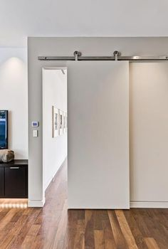 Installing interior barn door hardware can transform the look of your room. Read these steps in buying interior barn door hardware. Sliding Barn Door Track, Sliding Doors, Entry Doors, Front Doors, Sliding Wall, Front Entry, Patio Doors, Garage Doors, Modern Closet Doors