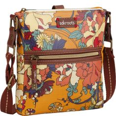 Sakroots Artist Circle Tablet Crossbody - To go back to my article about best handbags for travel, click here: http://www.boomerinas.com/2013/02/02/best-crossbody-bags-for-travel-women-over-40-50-60/