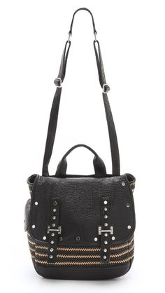 Rebecca Minkoff, this cool carry-all is outfitted with an adjustable shoulder strap and casual handle, and a buttoned pocket accents the back. The magnetic front flap opens to a lined interior with 3 pockets. Dust bag included. Cowhide leather.