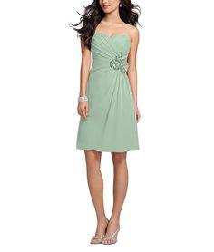DescriptionAlfred Angelo Style 7180SCocktaillength bridesmaid dressSweetheart neckline, gathered bodiceNatural waistFlower detailing at waist with flat front, gathered skirtChiffon
