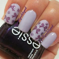  Sexy Divide by Essie, Charming by Revlon and Lavender Fizz by Milani. The bows were stamped using Essence's stamping kit!   @prettynailsbymal
