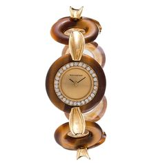 Boucheron lady's Yellow Gold Tiger's Eye Wristwatch | From a unique collection of vintage wrist watches at https://www.1stdibs.com/jewelry/watches/wrist-watches/
