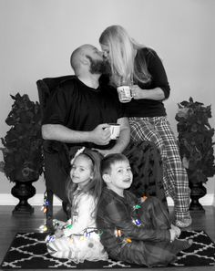 Family Christmas photo by Danielle. Indoor Photography. Black & White Photography. Christmas PJ theme photo. Kids wrapped in Christmas lights. Parents taking a break drinking coffee. Silent night theme.