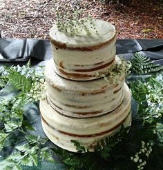 Semi-naked wedding cake. Filled with blueberry, raspberry, and blackberry compotes per layer. And frosted with a delicious marshmallow frosting!