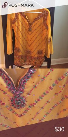 Indian kurti top Pretty mustard color with exquisite jewel and thread embroidery.  Bell sleeves with motifs on sleeves as well. Chest 19 inches and length 27 inches. Fully lined. Can fit medium to large Tops Tunics