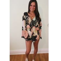 Long sleeve floral romper Long bell sleeved v cut floral romper purchased from ruby and Jenna boutique. LF for exposure. Worn once as pictured. Perfect condition- will post pictures off tomorrow LF Pants Jumpsuits & Rompers