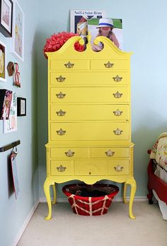 Yellow painted dresser.
