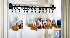 hang your spices behind a kitchen cabinet door