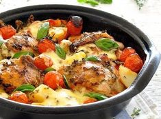 INGREDIENTS     	4 - 5 chicken thigh fillets, skin on and bone in (about 6oz/200g each)   	½ tbsp olive oil   	1 tin (14oz/400g) crushed tomatoes   	1½ cups cherry tomatos   	3 medium size potatoes (around 1.5lb/ 750g),
