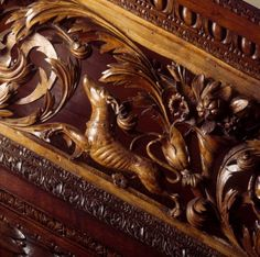 Detail of the carved balustrade of the staircase at Dunster, showing acanthus leaves, a beagling hound and a cornucopia. ©NTPL/Bill Batten