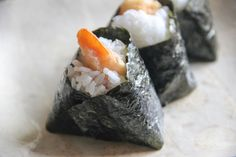 <p>Tenmusu areOnigiririce balls with shrimp Tempura as a filling. Onigiri is rice shaped bypressing firmly in your hands and forminginto a ball or triangle, or some other kind of shape. Typical fillings are pickled plum (Umeboshi),dried bonito flakeswith soy sauce (Okaka), or salted salmon. Tenmusu is something special, with Tempura …</p>