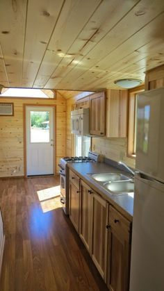 What a great kitchen.....there's plenty of space under the stairs for a combo washer/dryer AND pantry. Spacious Tiny House Living in Richs Portable Cabins