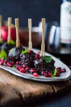 Moroccan Meatballs with Pomegranate Glaze- a festive holiday appetizer, or serve as a sumptious main dish with fluffy cous cous. | www.feastingathome.com