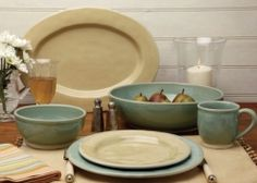Love these soothing colors.  I imagine the food cooks itself and dives onto the plates.   Dishware | AtHome Furnishings