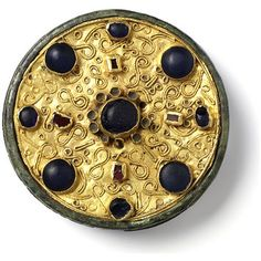 Brooch | Place of origin: France (probably, made) |  Date: 600-700 (made) | Bronze, inlaid with gold and embellished with filigree and pastes | Museum number: M.119-1939