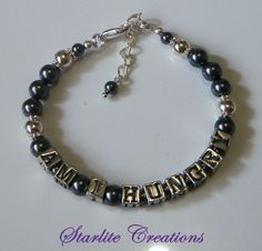 Swarovski Dark Grey Pearls, Silver plated spacers and Components.