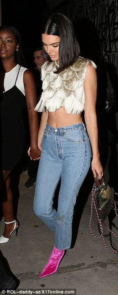 Popular gal: It girl Kendall revealed her toned tummy in a quirky ensemble that threw down the gauntlet for up and coming models trying to snatch her crown