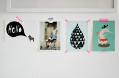 Use washi tape to hang photos - Ella And Louise