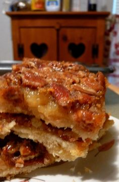 "Pecan Pie Bars! This is my go to dessert for parties and potlucks because it's baked in a 13x9 pan instead of a 9"" pie pan. It's also the first dessert to disappear!!! Sooo Goood!!!"