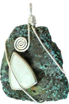 """Here we have a one-of-a-kind handcut primitive Kingman Turquoise (Arizona) large nugget that measures 35x41mm and has a manmade opal triangle stone set in sterling silver embellishing the front side.   The pendant is attached with a handmade wire wrapped sterling silver bail.  The overall size of the pendant is 2 3/16"""" tall."""