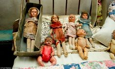 Collection: A number of threadbare dolls are also among the many lots going up for auction in a house barely touched since the '40's - June '15