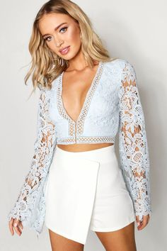 b8863ba5748a Click here to find out about the Flare Sleeve Plunge Lace Crochet Crop from  Boohoo