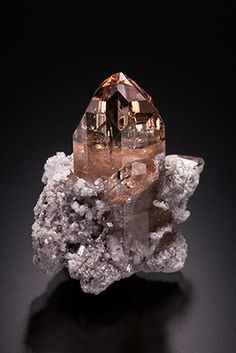 TOPAZ - Thomas Range, Juab County, Utah - Fully terminated sherry-colored topaz crystals up to 1.8 cm tall on ryholite matrix.-