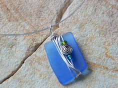 Check out this item in my Etsy shop https://www.etsy.com/listing/244959613/modern-wire-wrapped-recycled-blue-glass