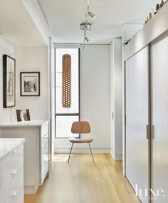 White Modern Hall with Closet Pocket Door