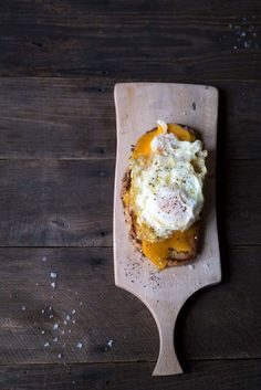 Want a treat yourself? This Open-Faced Grilled Cheese Sandwich is topped with mild cheddar cheese and a Spanish fried egg. It's total decadence. SavorySimple.net.