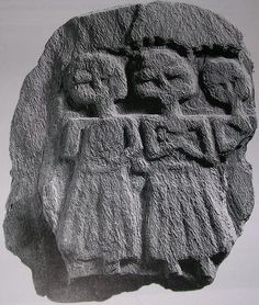 A small plaque of schist from Bath, England with three female figures representing the 'three mothers', a triad of deities. These triads of mother goddesses were common in the West of Britain in the early Roman period, probably reflecting an earlier Iron Age tradition. Original in the Roman Baths Museum, Bath UK.