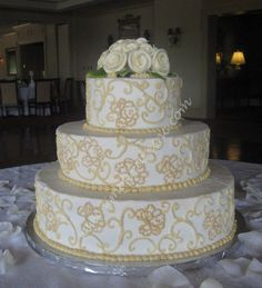 wedding cake with white icing roses | ... did all the swirls with royal icing. The roses are also royal icing