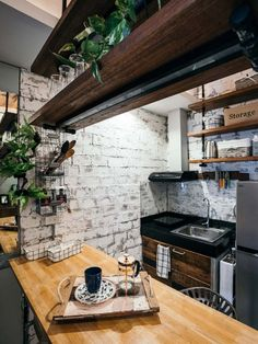 Wood and metal complete the coffee shop-inspired look of this cozy city haven Warm Industrial, Industrial House, Industrial Interiors, Condo Interior Design, Condo Design, Studio City Apartment, Small Condo, Rustic Cafe, Interior Concept