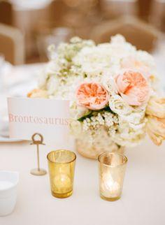 peachy blooms + dinosaur table numbers - photo by Laura Ivanova http://ruffledblog.com/spring-minneapolis-wedding