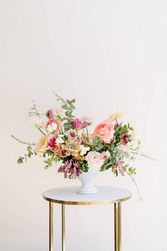 Beautiful spring centerpiece: How to Create the Prettiest Spring Centerpiece Centerpieces | Flowers | Wedding Decor | #flowers #weddingdecor #centerpieces | www.starlettadesigns.com