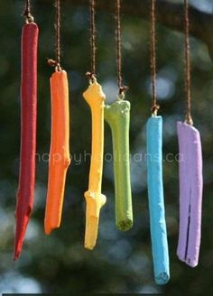 Wind chime from painted twigs Could add something metal to make better sound.