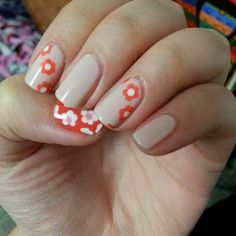 This nail tutorial shows how to create this pretty floral manicure using beige, orange, and white nail polish shades. Try this fun nail art with these fab products here.
