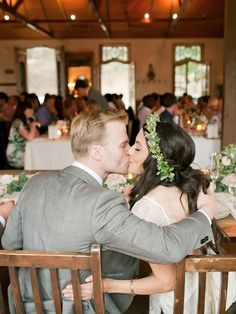 A cute kissing moment for the wedding reception photography shot list