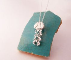 jellyfish necklace.....someday, when Lily is to old to drag Goochie around, I'll have to make this for her.  So he'll be near to her heart always <3