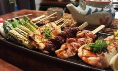Groupon - $ 18 for a Winter Yakitori Tasting Dinner with Drinks for Up to Four at Raku ($35.35 Value)  in Raku - Atlanta. Groupon deal price: $18